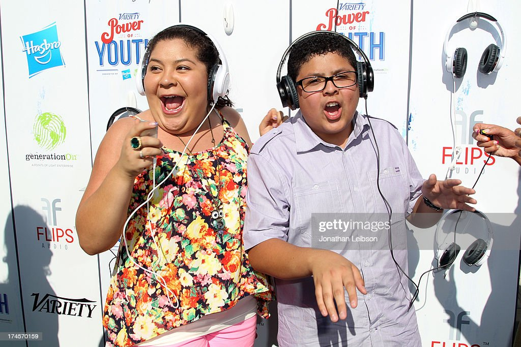 Actors Raini Rodriguez (L) and Rico Rodriguez attend Variety's Power of Youth presented by Hasbro, Inc. and generationOn at Universal Studios Backlot on July 27, 2013 in Universal City, California.