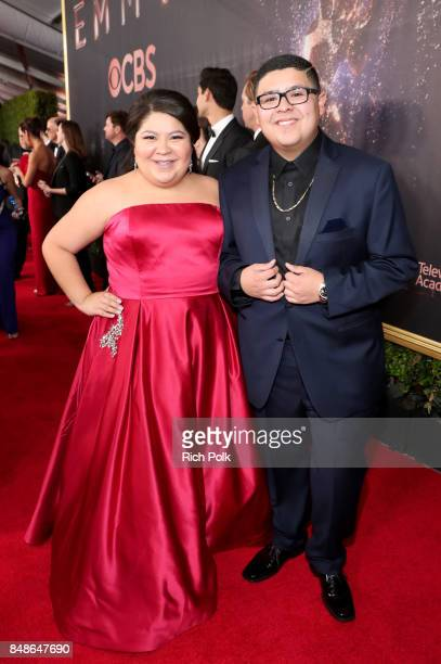 Actors Raini Rodriguez and Rico Rodriguez walk the red carpet during the 69th Annual Primetime Emmy Awards at Microsoft Theater on September 17 2017...
