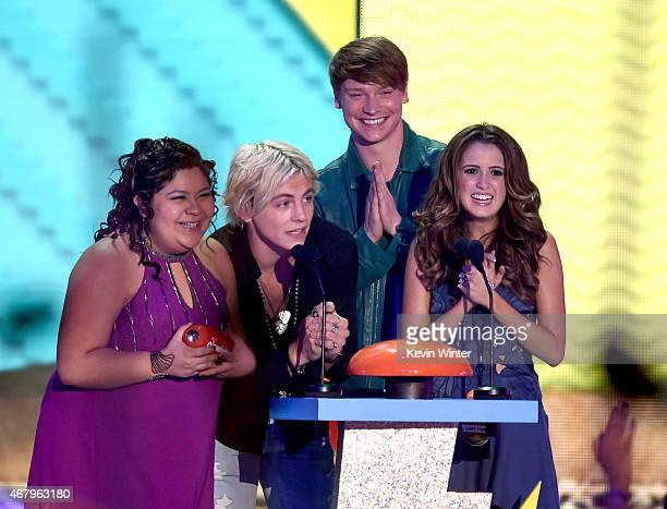 Actors Raini Rodriguez Ross Lynch Calum Worthy and Laura Marano accept award for Favorite Kids TV Show for 'Austin Ally' onstage during Nickelodeon's...