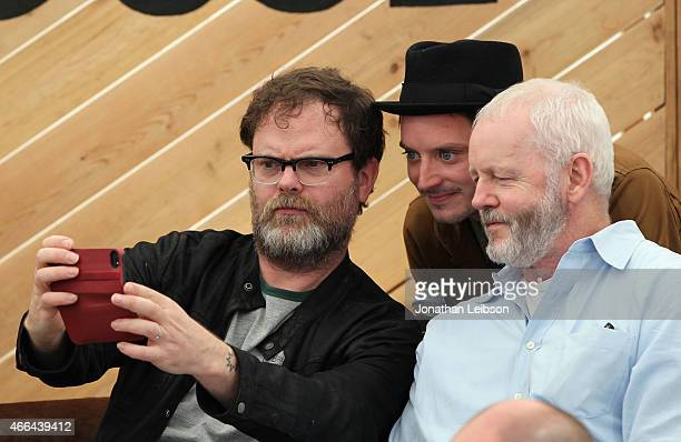 Actors Rainn Wilson Elijah Wood and David Morse take a selfie at the Roc Nation and Live Nation Raptor House for AOL BUILD on March 15 2015 in Austin...
