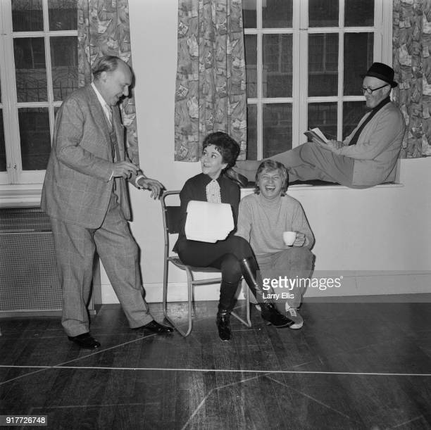 Actors Ralph Richardson Joan Plowright Tommy Steele and Alec Guinness reading the script for television production of Twelfth Night for the first...