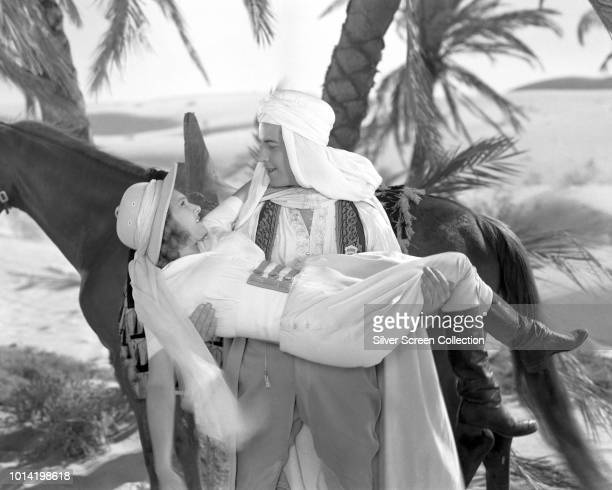 Actors Ramon Novarro as Ahmed Ben Nesib and Lola Lane as Phyllis 'Flip' Murdock in a scene from the film 'The Sheik Steps Out', 1937.