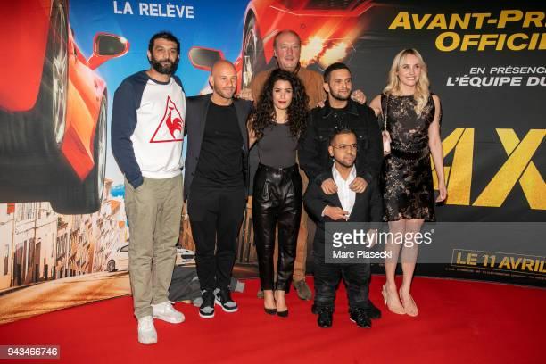 Actors Ramzy Bedia Franck Gastambide Sabrina Ouazani Bernard Farcy Malik Bentalha Anouar Toubali and Sand Van Roy attend the 'Taxi 5' Premiere at Le...