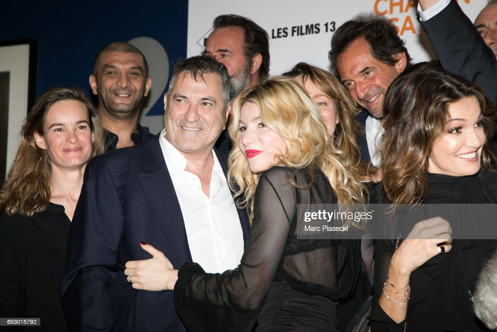 Actors Ramzy Bedia, Jean-Marie Bigard, Jean Dujardin, Lola Marois, Julie Ferrier, Stephane de Groodt and Nadia fares attend the 'Chacun sa vie' Premiere at Cinema UGC Normandie on March 13, 2017 in Paris, France.