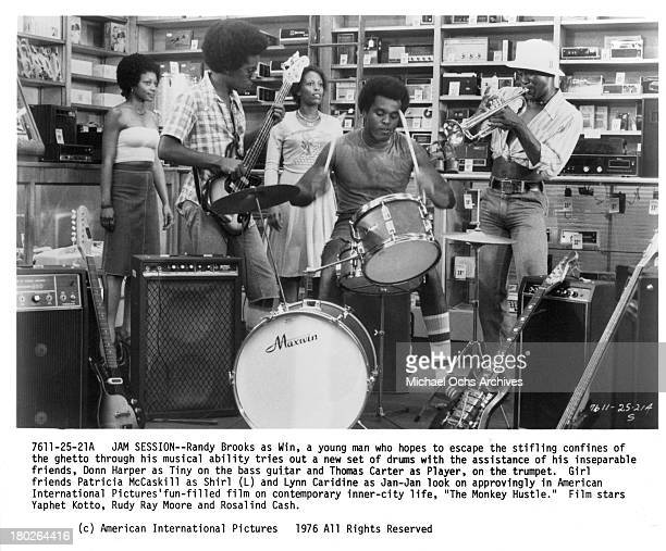 Actors Randy Brooks on drums Donn Harper on bass guitar Thomas Carter on trumpet as actresses Patricia McCaskill and Lynn Harris look on set for the...