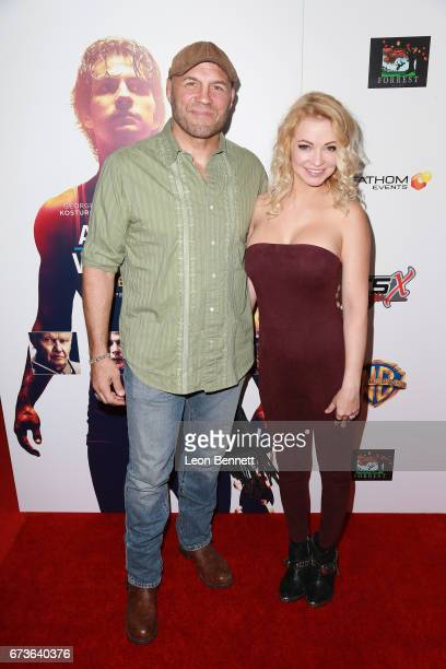 Actors Randy Couture and Mindy Robinson attends the Premiere Of Warner Bros Home Entertainment's 'American Wrestler The Wizard' at Regal LA Live...