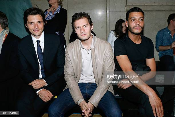 Actors Raphael Personnaz Hugo Becker and Adele Bencherif attend the Cerruti show as part of the Paris Fashion Week Menswear Spring/Summer 2015 on...