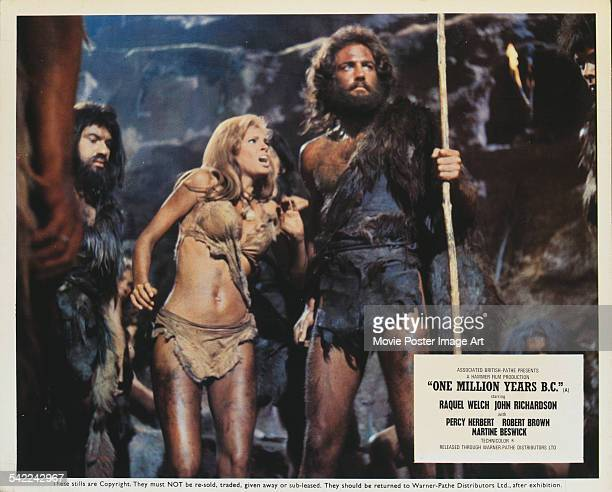 Actors Raquel Welch and John Richardson appear on a poster for the Hammer Films production 'One Million Years BC' 1966