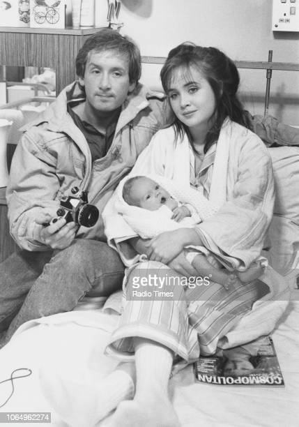 Actors Ray Burdis and Lysette Anthony with a newborn baby in a scene from the television sitcom 'Three Up Two Down' February 16th 1985