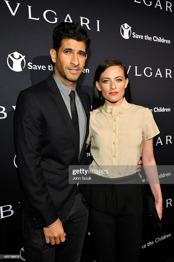 Actors Raza Jaffrey and Lara Pulver attend BVLGARI and Save The Children STOP. THINK. GIVE. Pre-Oscar Event at Spago on February 17, 2015 in Beverly Hills, California.