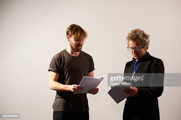 Actors reading though script together.