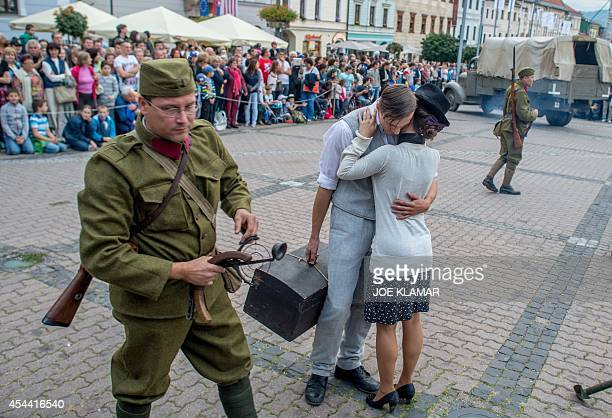 Actors reanact scenes from mobilisation at the SNP square in the central Slovak town of Banska Bystrica on August 30 2014 to commemorate the 70th...
