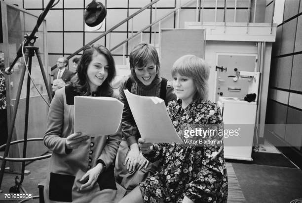 Actors recording an episode of the radio series 'The Archers': from left to right Elizabeth Marlowe, Judy Bennett and Angela Piper, UK, 30th November...