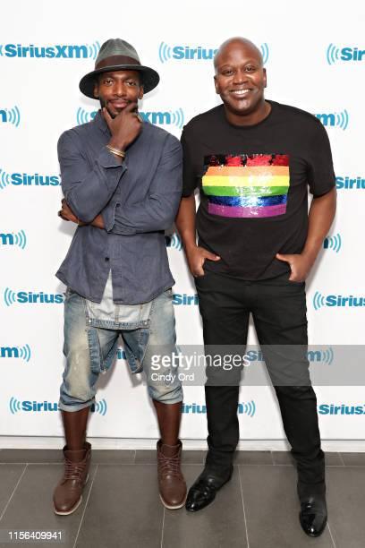 Actors/ recording artists Daniel J. Watts and Tituss Burgess visit the SiriusXM Studios on July 18, 2019 in New York City.