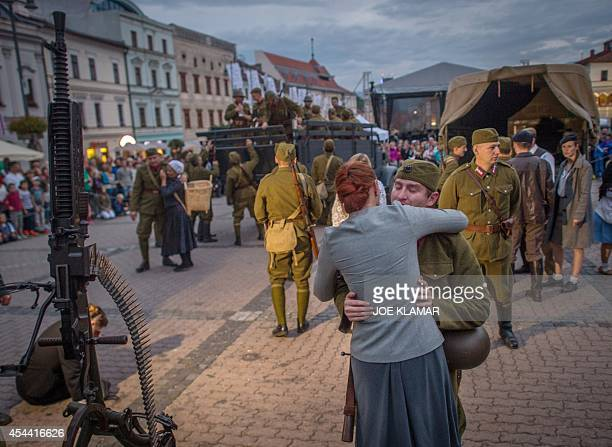 Actors reenact scenes from mobilisation at the SNP square in the central Slovak town of Banska Bystrica on August 30 2014 to commemorate the 70th...