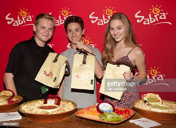 Actors Reese Hartwig Teo Halm and Ella Wahlestedt with Sabra At 1027 KIIS FM's 2014 Wango Tango Gifting Suite at StubHub Center on May 10 2014 in Los...