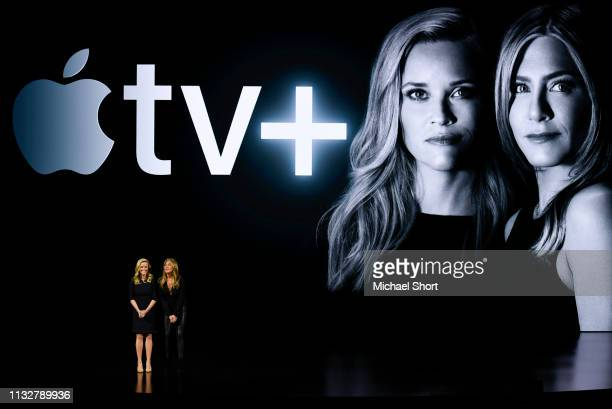 Actors Reese Witherspoon and Jennifer Aniston speak during an Apple product launch event at the Steve Jobs Theater at Apple Park on March 25 2019 in...