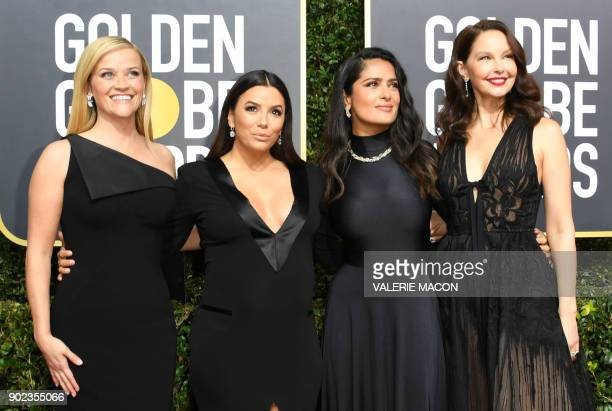 Actors Reese Witherspoon Eva Longoria Salma Hayek and Ashley Judd arrive for the 75th Golden Globe Awards on January 7 in Beverly Hills California /...