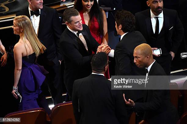 Actors Reese Witherspoon Matt Damon Benicio del Toro and musician Pharrell Williams in the audience during the 88th Annual Academy Awards at the...