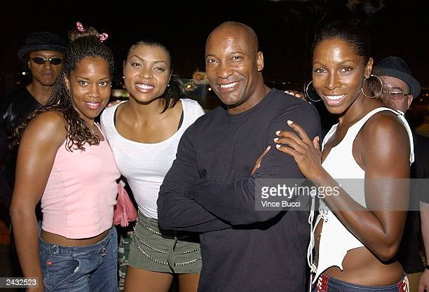 Actors Regina King Taraji Henson director John Singleton and actress AJ Johnson attend a party in Singleton's honor at Loggia on August 26 2003 in...