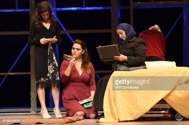 Actors Reham Kassar Nanda Mohammad Hanan Chkir perform during a dress rehearsal for 'While I was Waiting' as part of Lincoln Center Festival at...
