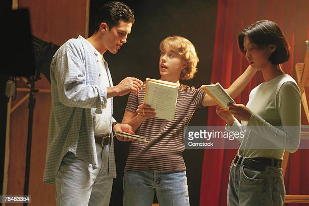 Actors rehearsing lines backstage
