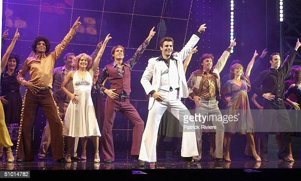 Actors Renee Berry and AdamJon Fiorentino perform during a photocall to introduce the cast of the new production of Saturday Night Fever at the Lyric...