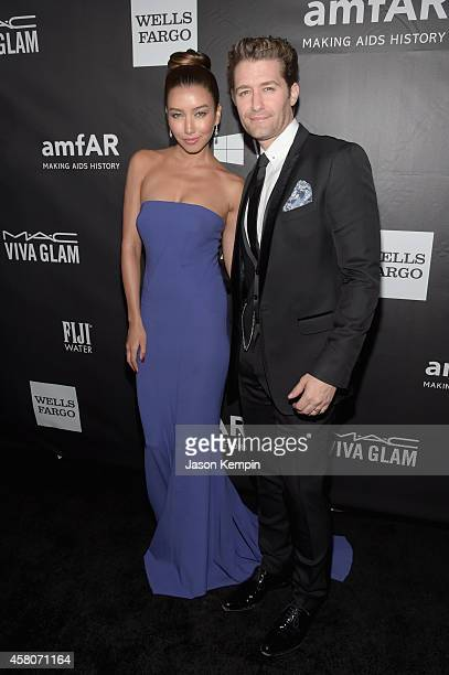 Actors Renee Puente and Matthew Morrison attend amfAR LA Inspiration Gala honoring Tom Ford at Milk Studios on October 29 2014 in Hollywood California