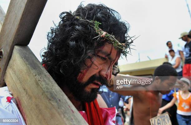 Actors represent the Via Crucis procession as part of Good Friday ceremonies on April 10 2009 at Montebello municipality outskirts of Cali Valle del...