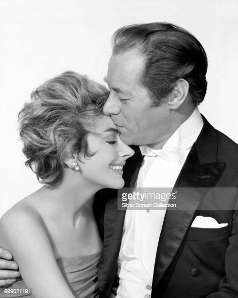 Actors Rex Harrison as Jimmy Broadbent and Kay Kendall as Sheila Broadbent in a publicity still for 'The Reluctant Debutante' 1958