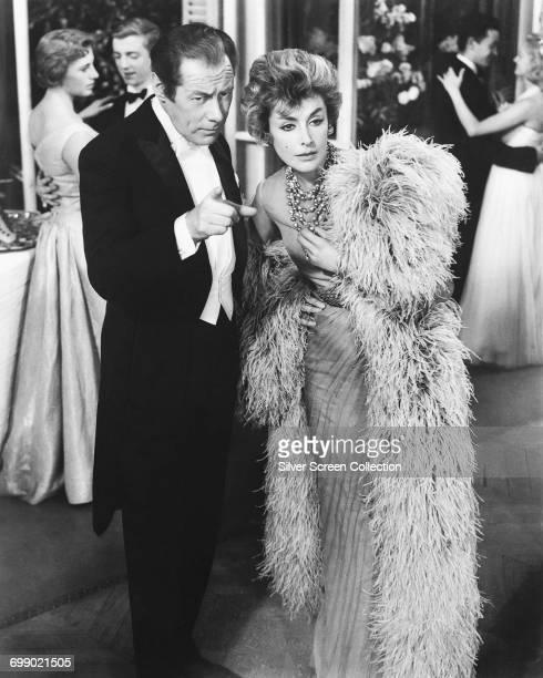 Actors Rex Harrison as Jimmy Broadbent and Kay Kendall as Sheila Broadbent in the film 'The Reluctant Debutante' 1958
