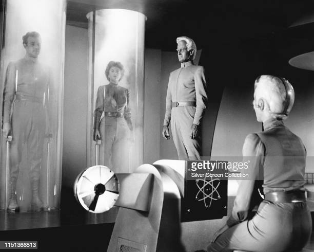 Actors Rex Reason as Dr Cal Meacham Faith Domergue as Dr Ruth Adams and Jeff Morrow as Exeter in the science fiction film 'This Island Earth' 1955