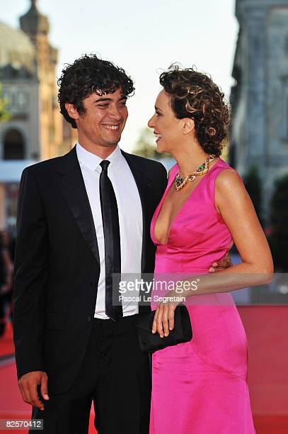 Actors Riccardo Scamarcio and Valeria Golino arrive at the opening ceremony and 'Burn After Reading' Premiere during the 65th Venice Film Festival at...