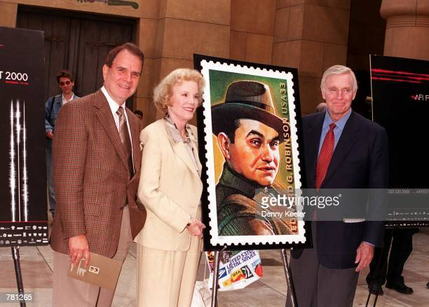 Actors Rich Little Nanette Fabray and Charlton Heston unveil the Edward G Robinson postage stamp during a ceremony where the late actor was honored...