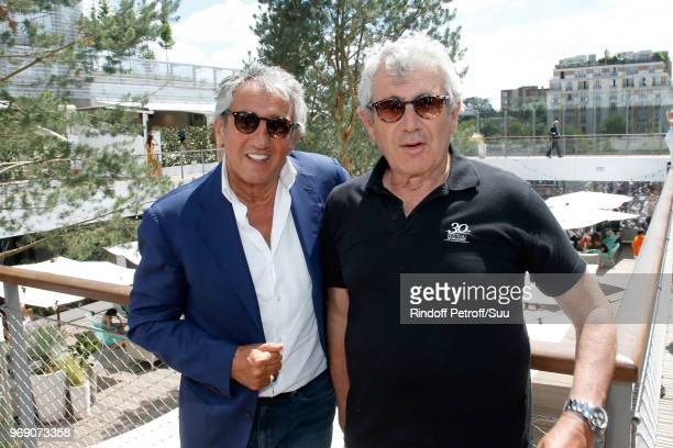 Actors Richard Anconina and Michel Boujenah attend the 2018 French Open - Day Twelve at Roland Garros on June 7, 2018 in Paris, France.