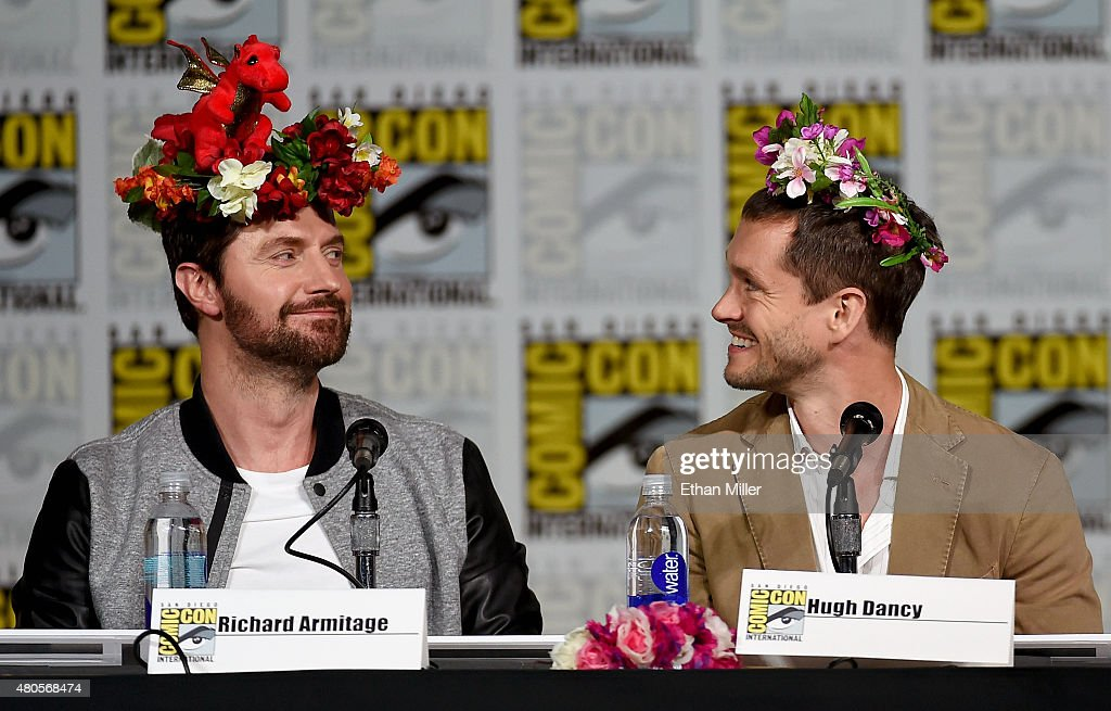Actors Richard Armitage (L) and Hugh Dancy wear flower crowns at the 'Hannibal' Savor the Hunt panel during Comic-Con International 2015 at the San Diego Convention Center on July 11, 2015 in San Diego, California.