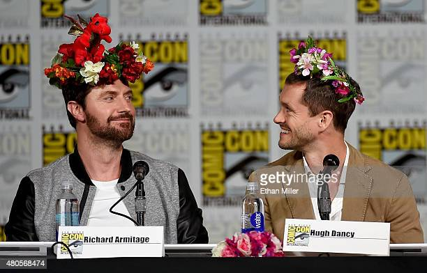 Actors Richard Armitage and Hugh Dancy wear flower crowns at the Hannibal Savor the Hunt panel during ComicCon International 2015 at the San Diego...