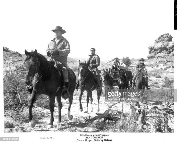 Actors Richard Boone Anthony FranciosaStuart Whitman and Jim Brown on set of the 20th Century Fox movie Rio Conchos in 1964