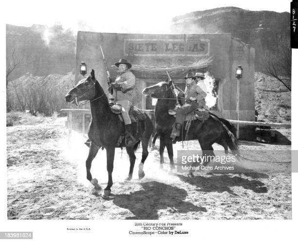 Actors Richard Boone Stuart Whitman and Jim Brown on set of the 20th Century Fox movie Rio Conchos in 1964