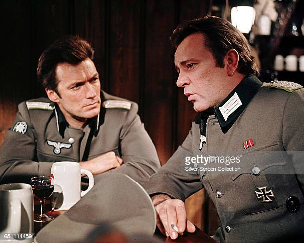 Actors Richard Burton as Major Jonathan Smith and Clint Eastwood as Lieutenant Morris Schaffer both posing as German officers in the wartime thriller...
