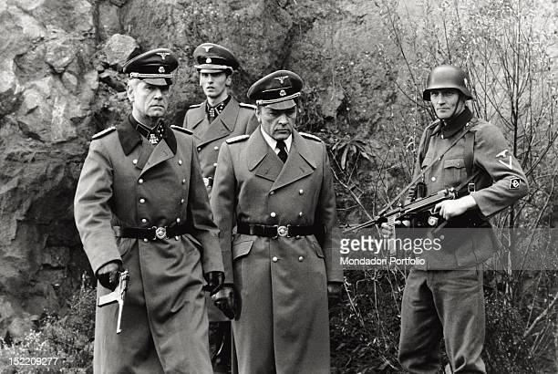 Actors Richard Burton as the Gestapo chief Herbert Kappler and Anthony Steel as Major Domizlaf in a scene from the movie Massacre in Rome the film is...