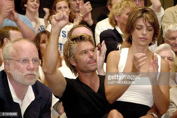 US actors Richard Dreyfuss Harry Hamlin and his wife Lisa Rinna listen to a speech in support of the sevenweek actors' unions strike against the...