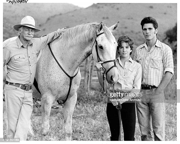Actors Richard Farnsworth actress Melissa Gilbert and Michael Schoeffling pose in a scene from the movie Sylvester circa 1985