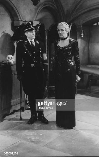 Actors Richard Gibson and Kim Hartman in a scene from episode 'Watch the Birdie' of the television sitcom ''Allo 'Allo' March 18th 1988