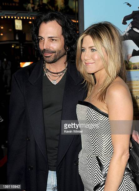 Actors Richard Grieco and Jennifer Aniston arrive at the premiere of Universal Pictures' Wanderlust held at Mann Village Theatre on February 16 2012...