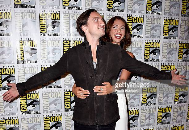 Actors Richard Harmon and Lindsey Morgan attend The 100 Press Line during ComicCon International 2016 at Hilton Bayfront on July 22 2016 in San Diego...