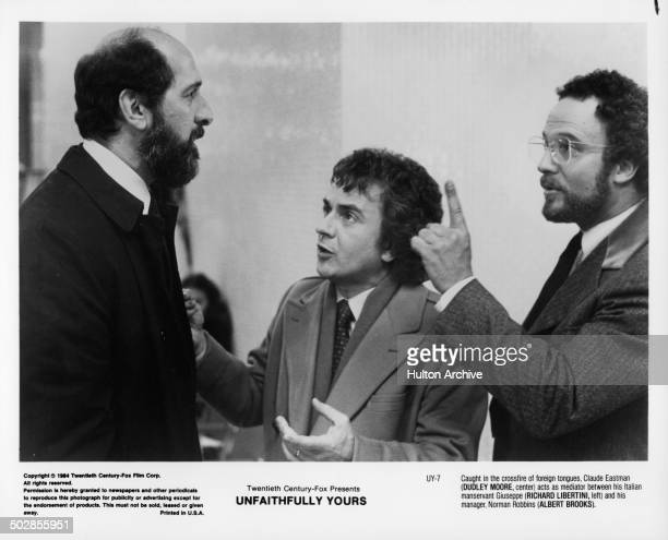 Actors Richard Libertini actor Dudley Moore and Albert Brooks argues in a scene during the 20th Century Fox movie Unfaithfully Yours circa 1984