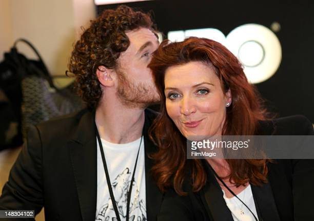 "Actors Richard Madden and Michelle Fairley sign autographs for HBO's ""Game Of Thrones"" during Comic-Con International 2012 at San Diego Convention..."