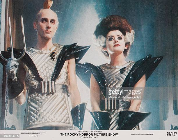 Actors Richard O'Brien and Patricia Quinn appear as Riff Raff and Magenta on a lobby card from the 1975 musical comedy 'The Rocky Horror Picture...