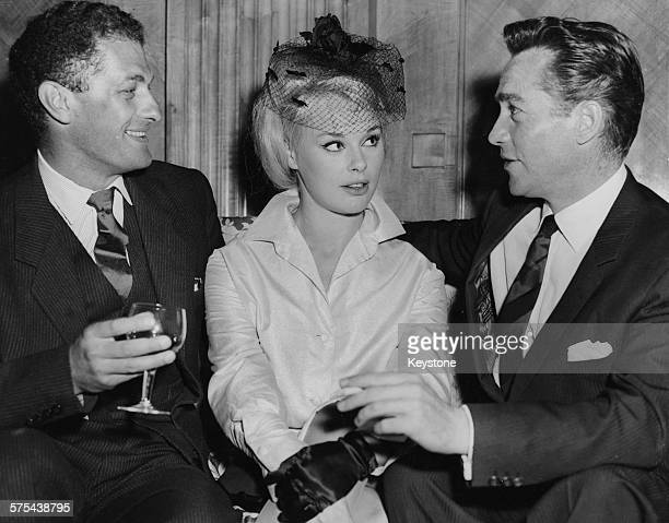 Actors Richard Todd and Elke Sommer with film director Cyril Frankel at a reception for their film 'Don't Bother to Knock' at the Dorchester Hotel...